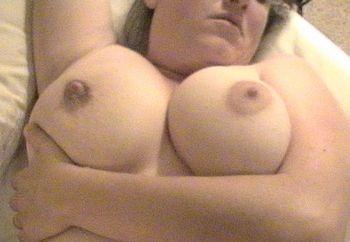 diane posing in bed