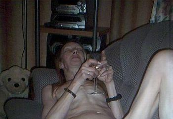 Skinny Mature Relaxes On The Couch