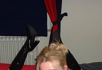 my thigh-high black pvc boots