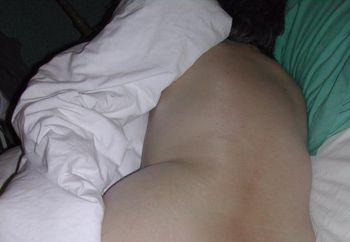 My wife rolling around on the bed
