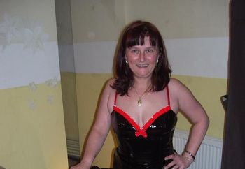 Deejay in PVC dress and boots pt2