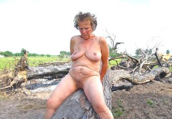 Mature nude female in open field