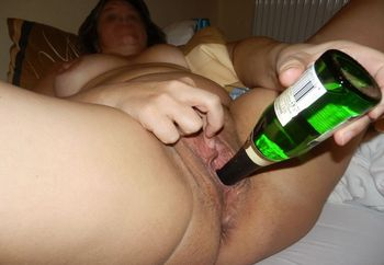 Bottle in juicy mature pussy