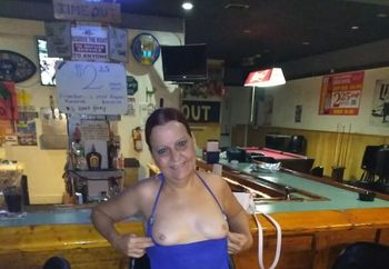 Rosemary flashing her tits at the bar
