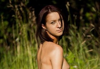 Amy strips in a field 2