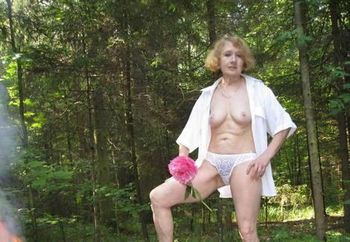 Mature woman in the forest.