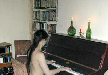 Sexy girl playing piano