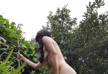 naked in tropical garden
