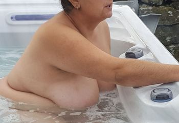 Tits on show in a hot tub
