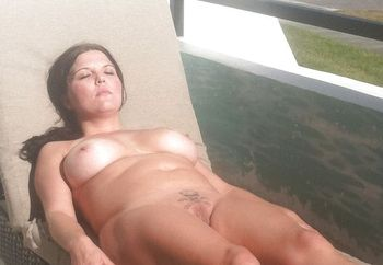 sunbathing nude by the road