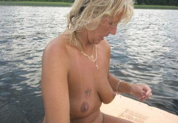 Blonde lady nude on the lake