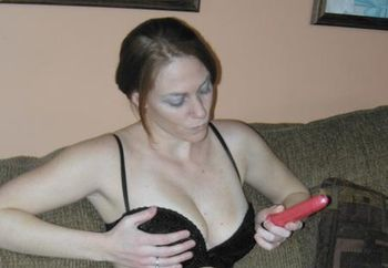 Redhead coed Mariah plays with her toy