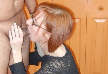 Mature redhead Layla sucks some dick