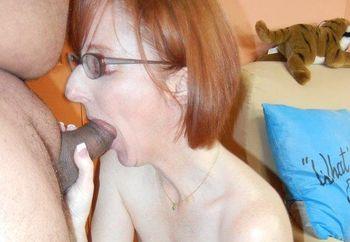 Mature redhead Layla is sucking dick