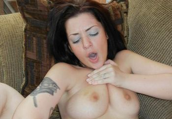 Melina Mason plays with her wet pussy