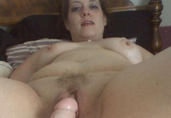 playing with a dildo