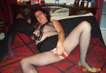 hotsexycple playin with her toy on the bed