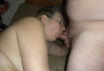 Giving him a blow job