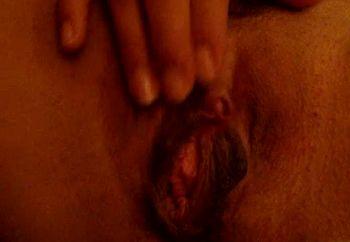 Sarina stroking her clit.