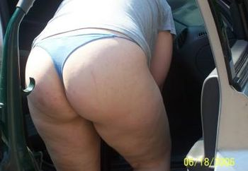My wife naked in the car