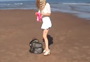 Hot wife strips at public beach