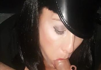 in costume sucking and swallowing