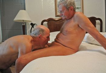 Bruce on his knees sucking Jack's cock
